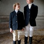 Boys Wearing Horse Riding Clothes In Stable High Res Stock Photo Getty Images