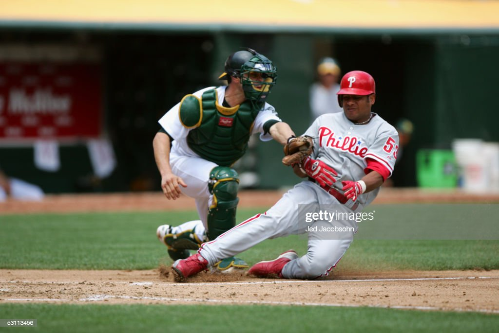 Catcher Jason Kendall of the Oakland Athletics tags ...