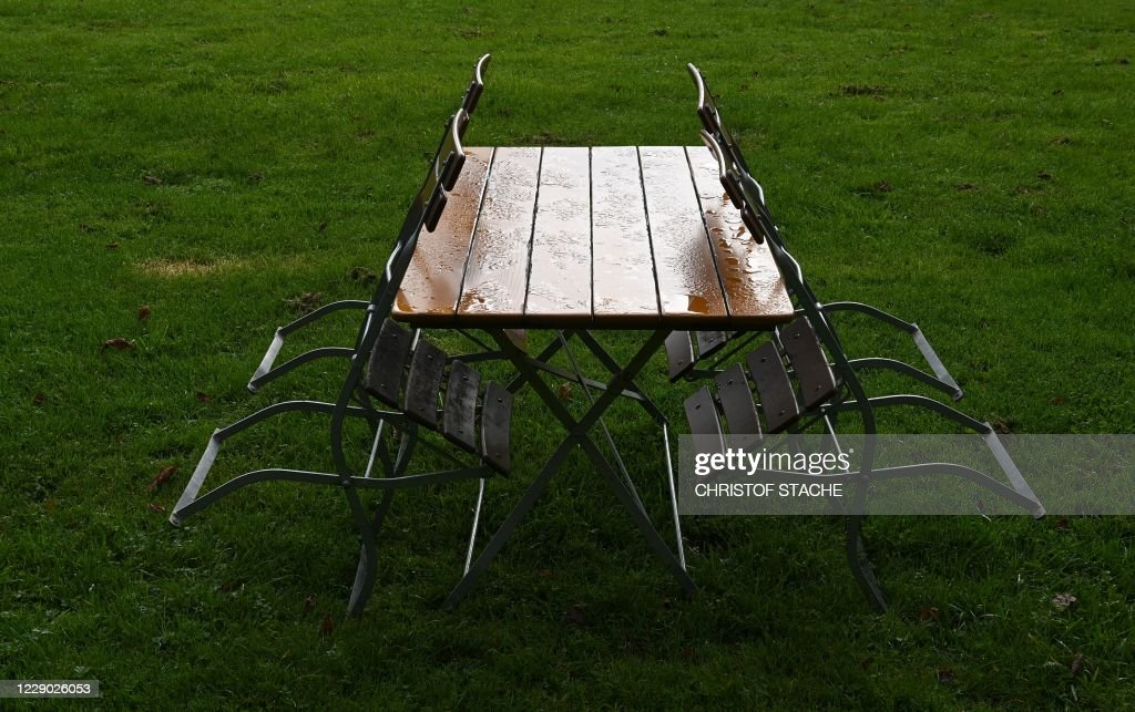 https www gettyimages com detail news photo chairs lean on a wet table at an open air snack bar near news photo 1229026053