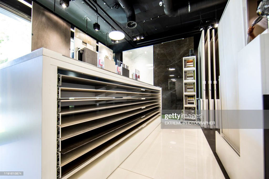 contemporary interior of a bathroom accessories supplier shop with many tile and flooring samples on display high res stock photo getty images