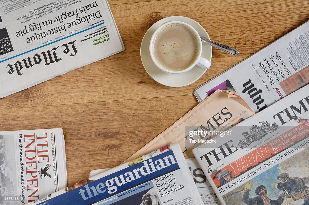 https www gettyimages com detail news photo cup of coffee and newspapers on a table february 8 2011 news photo 137311346