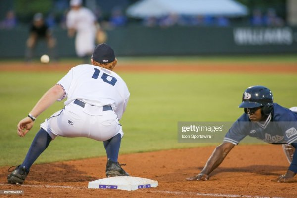 Dallas Baptist outfielder Jameson Hannah dives to avoid a ...