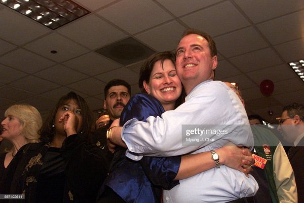Eve and Adam Schiff share a hug as they and supporters ...