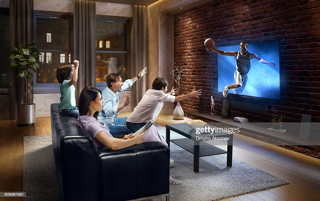 Family With Children Cheering And Watching Basketball Game On Tv Stock Photo Getty Images