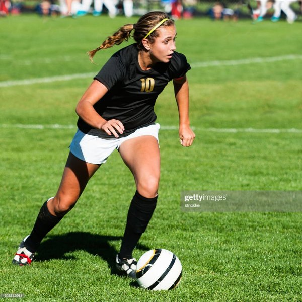 Female Soccer Player Showing Mega Intensity With Eyes Up ...