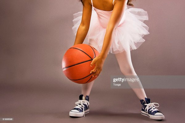 Girl Dribbling Basketball Wearing Ballet Outfit Stock ...