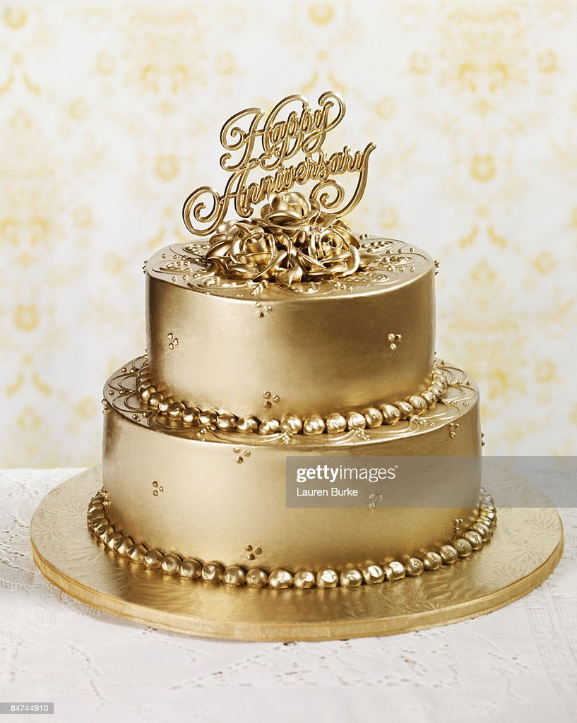 50th Wedding Anniversary Stock Photos and Pictures   Getty Images Gold Anniversary Cake