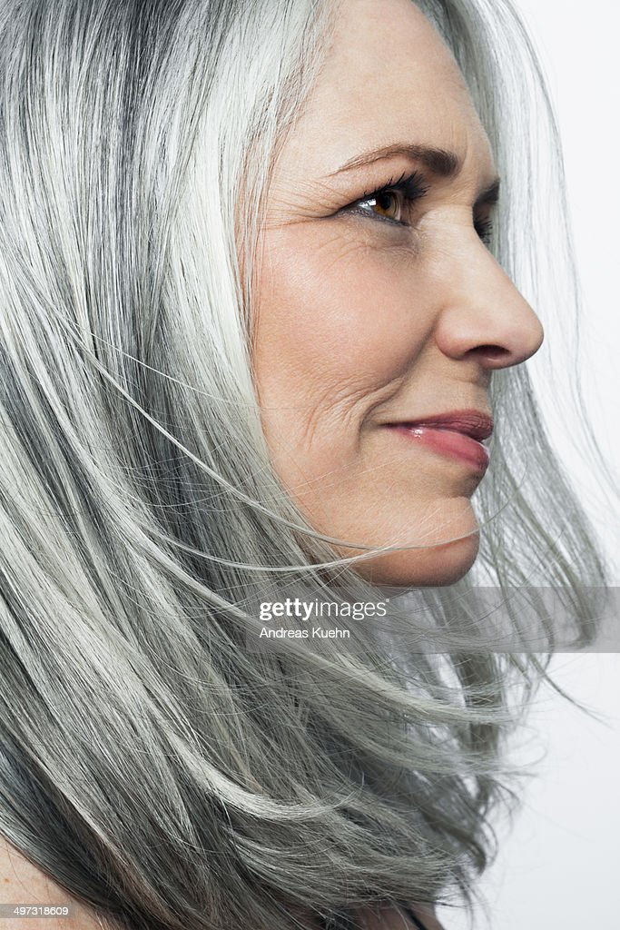 Grey Haired Woman With A Soft Smile Profile Stock Photo