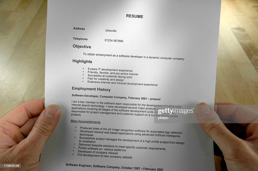 A Hands Holding A Resume In High Definition Quality Image Stock     A Hands Holding A Resume In High Definition Quality Image Stock Photo    Getty Images