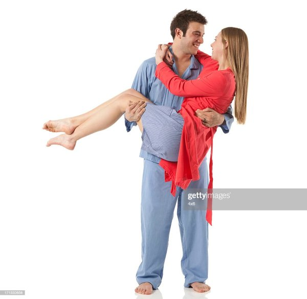 Happy Man Romantically Carrying Wife In His Arms High-Res ...