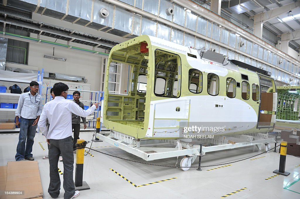 Indian technicians work in the Sikorsky S-92 helicopter ...