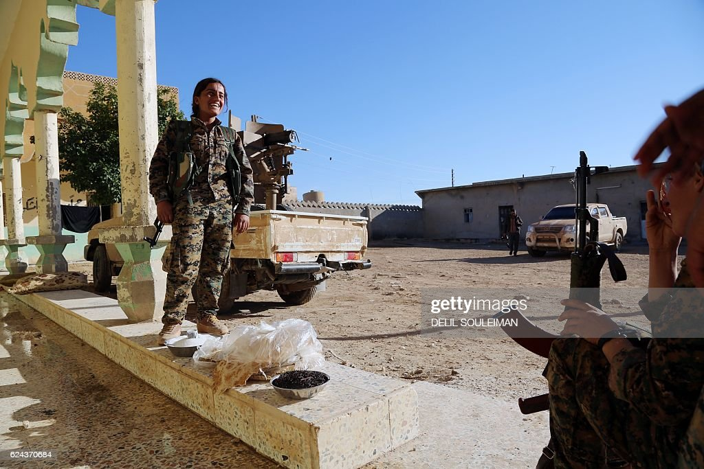Kurdish female Women's Protection Units (YPJ) rest in a ...