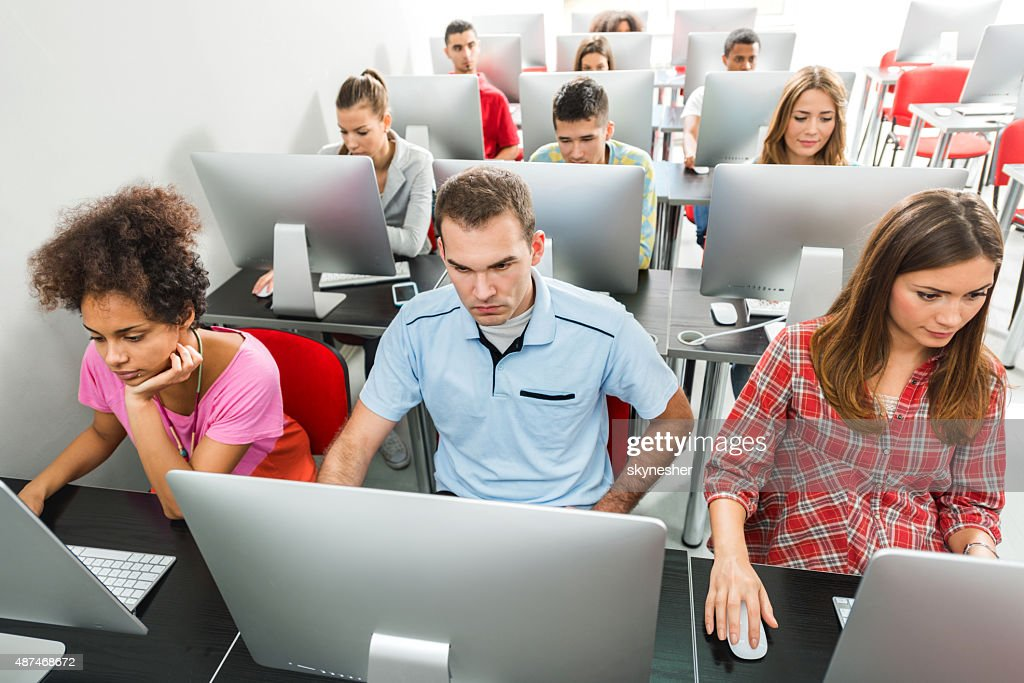 Large Group Of People Using Computer In A Computer Lab ...