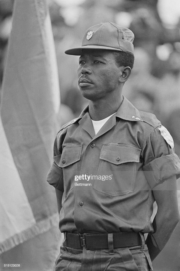 Lt Col Mengistu Haile Mariam stands at ease before an