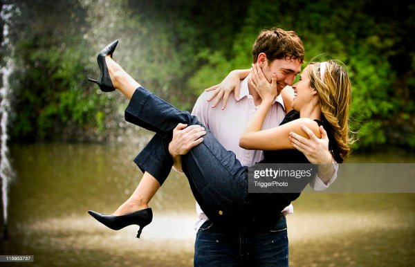 Man Carrying Woman In His Arms Like A Bride Over Threshold ...