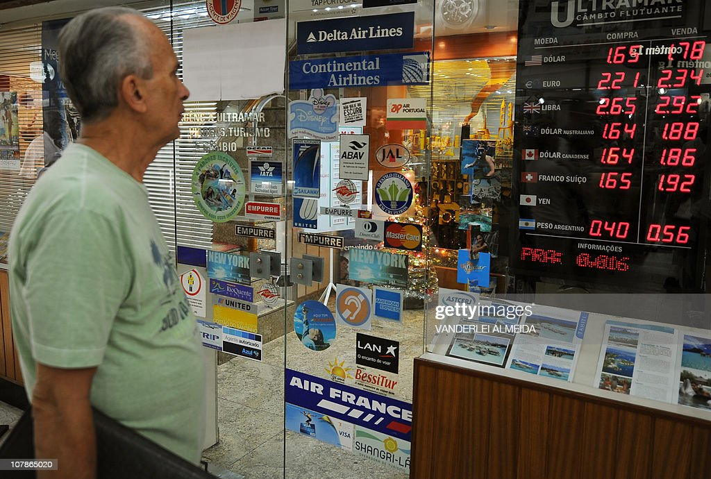 a man looks at the placard of a bureau d news photo
