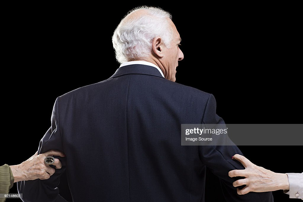 Man With Female Hands Grabbing His Arms High-Res Stock ...