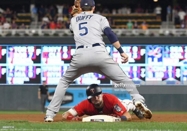 Minnesota Twins Outfield Jake Cave slides under the tag of ...