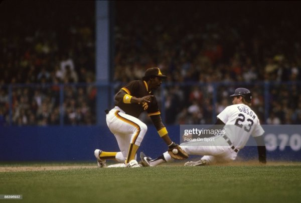 Outfielder Kirk Gibson is safe at second base beating the ...