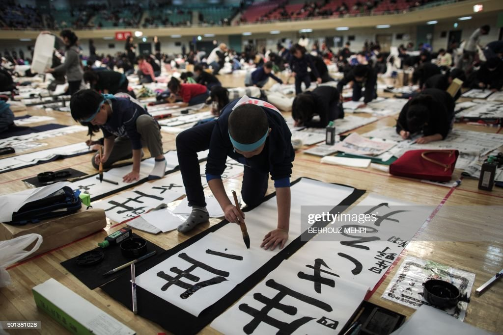New Year calligraphy contest in Tokyo Photos and Images   Getty Images Participants write Japanese calligraphy during the annual New Year  calligraphy contest in Tokyo on January 5
