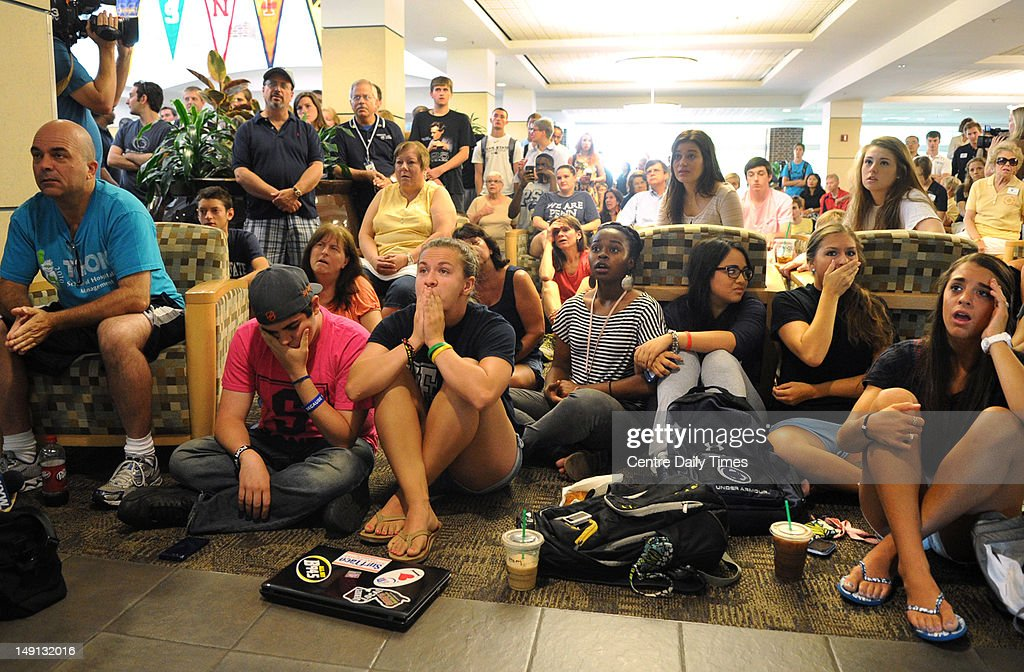 People at the HUB building at Penn State University react ...