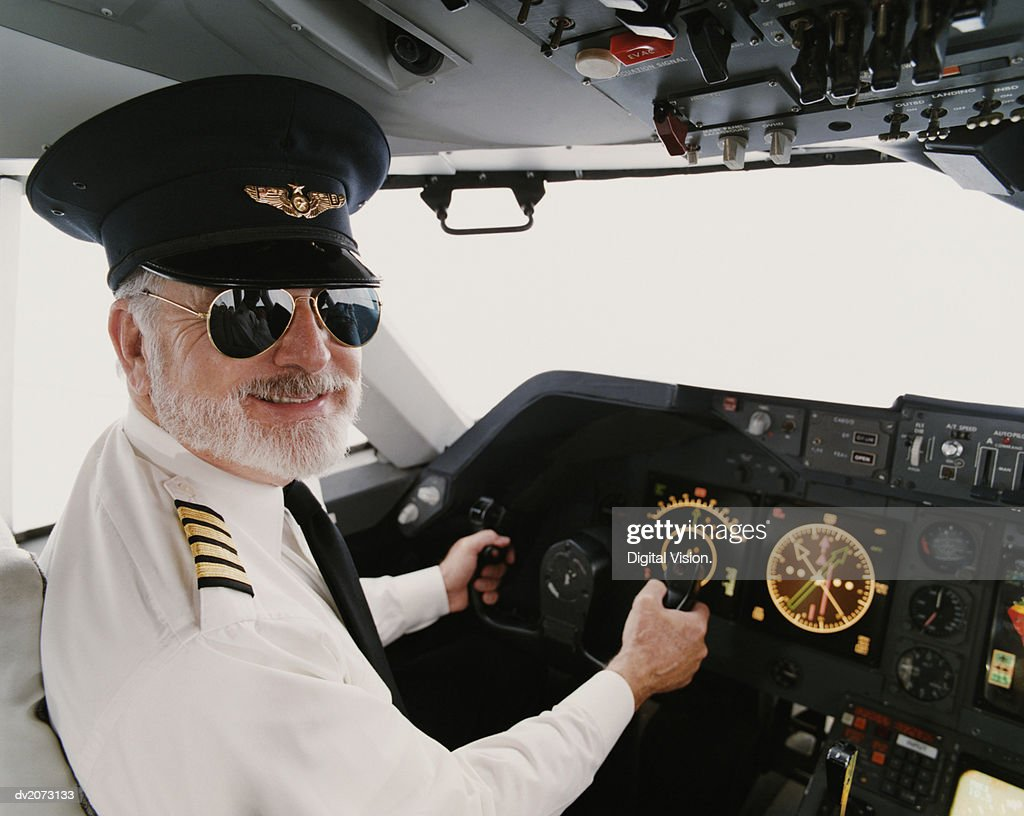 Portrait Of A Male Pilot Sitting In The Cockpit High-Res ...