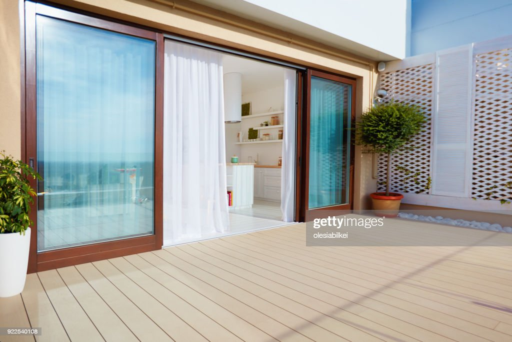 https www gettyimages com detail photo roof top patio with open space kitchen sliding royalty free image 922540108
