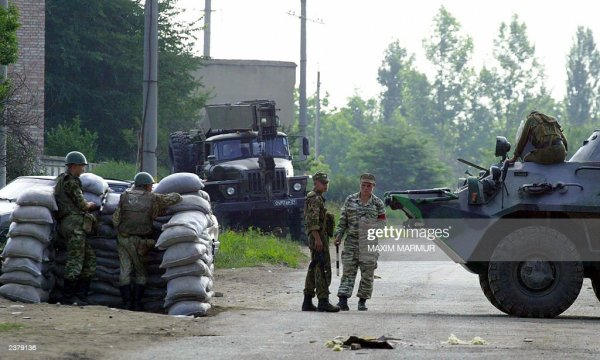 Russian soldiers stand guard at the checkpoint near the ...