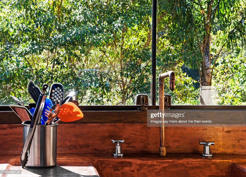 rustic kitchen with copper faucet and terracotta sink still life high res stock photo getty images