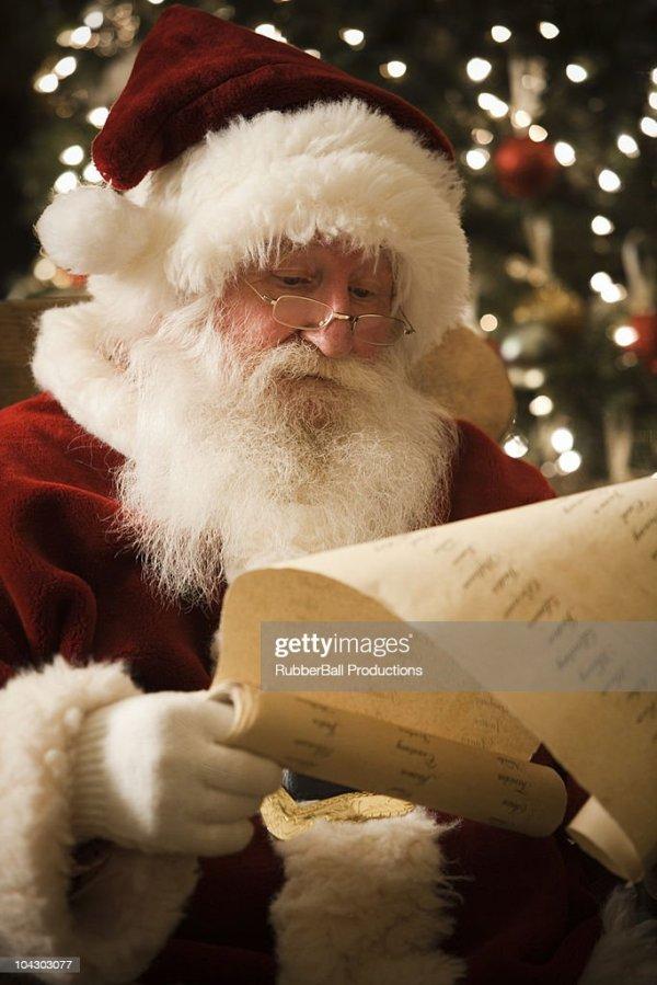 Santa Claus Checking His Naughty And Nice List Stock Photo ...