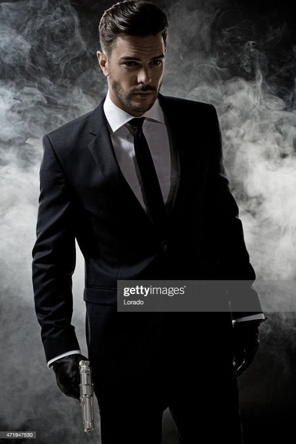 Sexy Man Wearing Suit Holding Gun Stock Photo   Getty Images