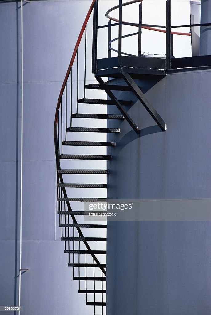 Spiral Staircase On Storage Tank High Res Stock Photo Getty Images   Spiral Staircase Design For Tanks   Wrought Iron   Architecture   Handrail   Steel   Stair Railing