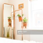 Stylish Bedroom With A Four Poster Bed And Large Copper Mirror High Res Stock Photo Getty Images