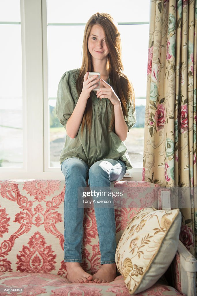 Teen Girl At Home With Phone Stock Photo | Getty Images on Small:zikqrscfop8= Teenage Girls  id=48999