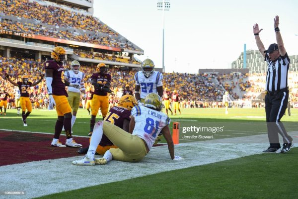 Tight end Caleb Wilson of the UCLA Bruins scores a ten ...