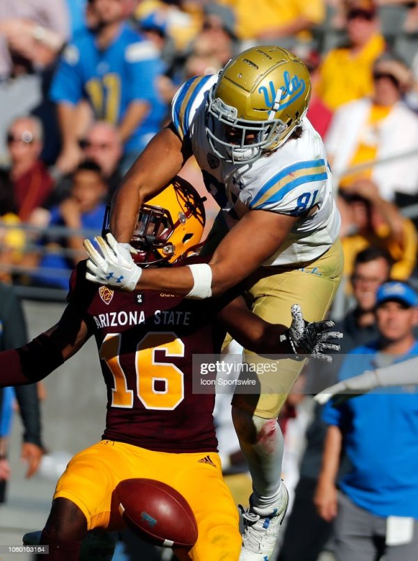 Tight end Caleb Wilson of the UCLA Bruins tries to make a ...