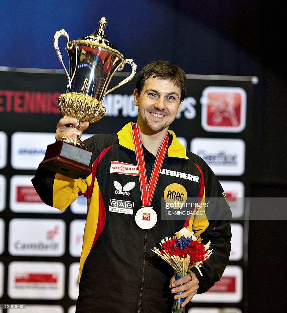 Timo Boll of Germany celebrates after winning against ...