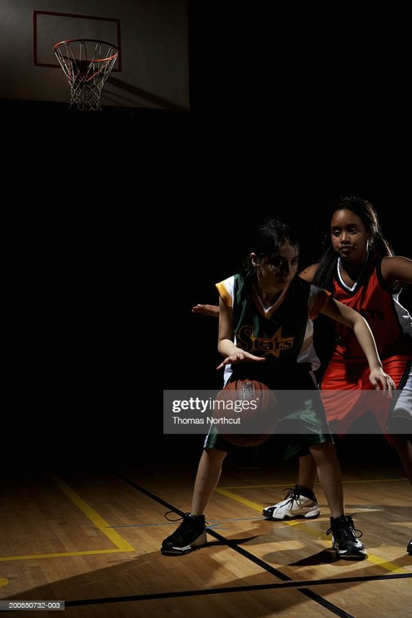 Two Girls Playing Basketball Stock Photo | Getty Images