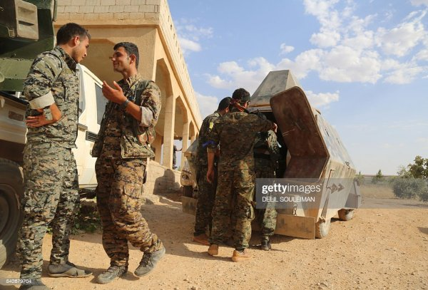 US-backed Kurdish and Arab fighters chat as they advance ...