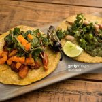 Vegetarian Tacos On A Serving Platter On A Wooden Restaurant Table High Res Stock Photo Getty Images