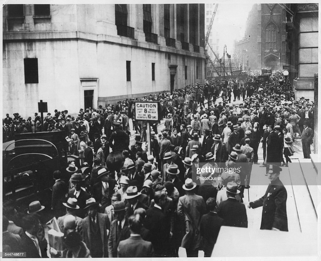 View Of Crowds Of People On Wall Street During The Stock