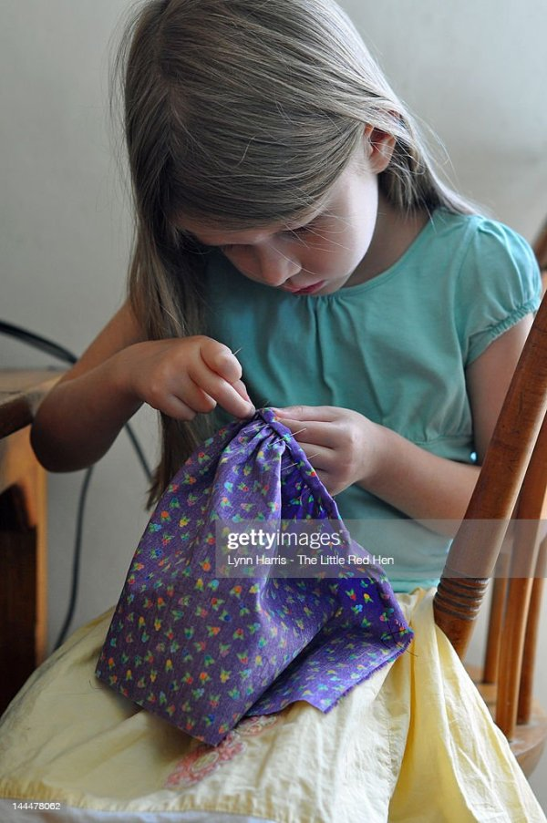 Young Girl Hand Sewing Stock Photo - Getty Images
