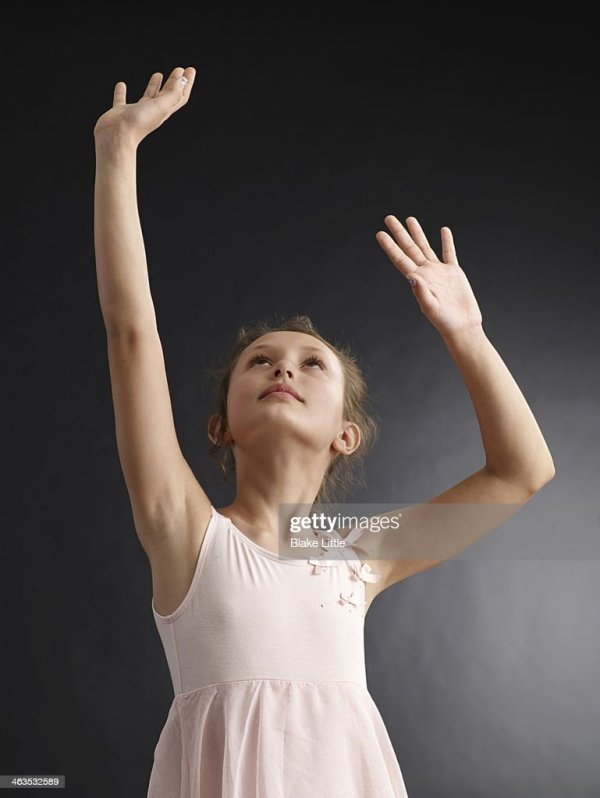 Young Girl Reaching Up Hands Up High-Res Stock Photo ...