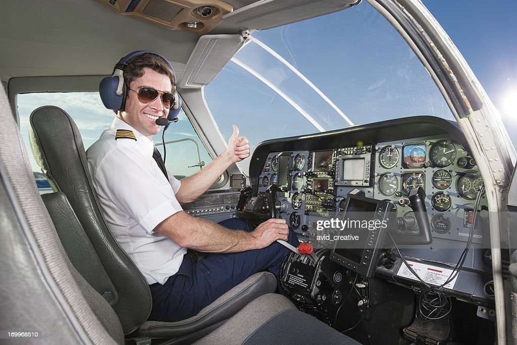 Young Pilot In Aircraft Cockpit Giving Thumbs Up Stock ...