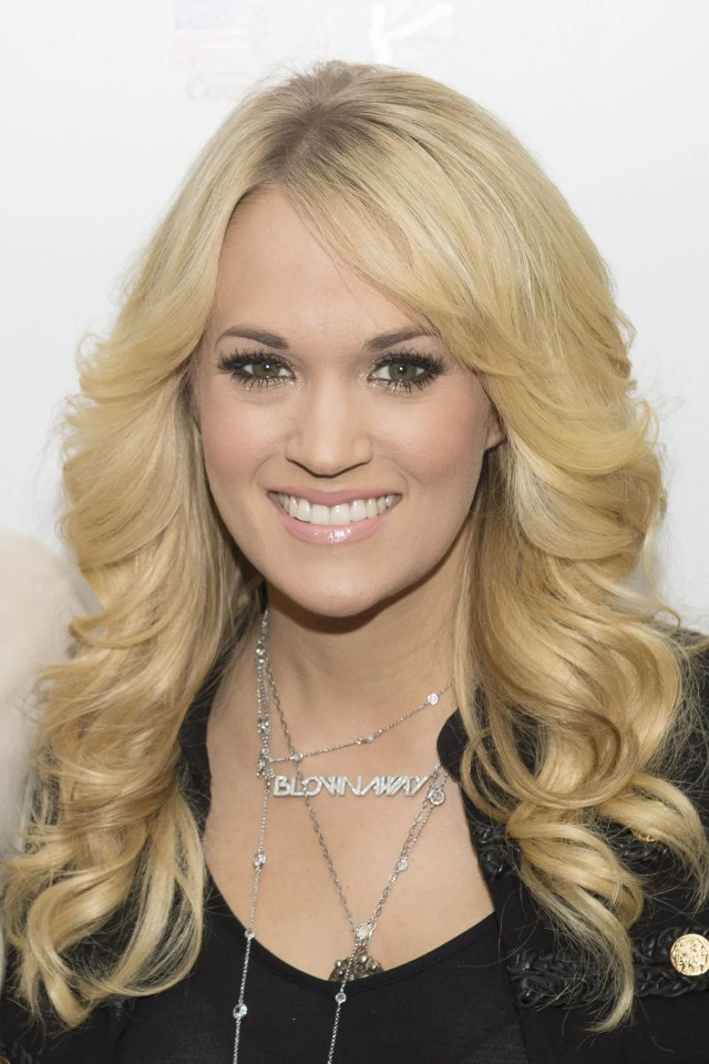 """i call this hairstyle on carrie underwood """"baby farrah hair"""