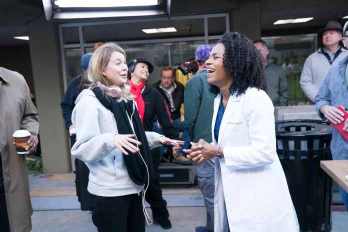 Ellen Pompeo talking to Kelly McCreary while directing an episode of Grey's Anatomy