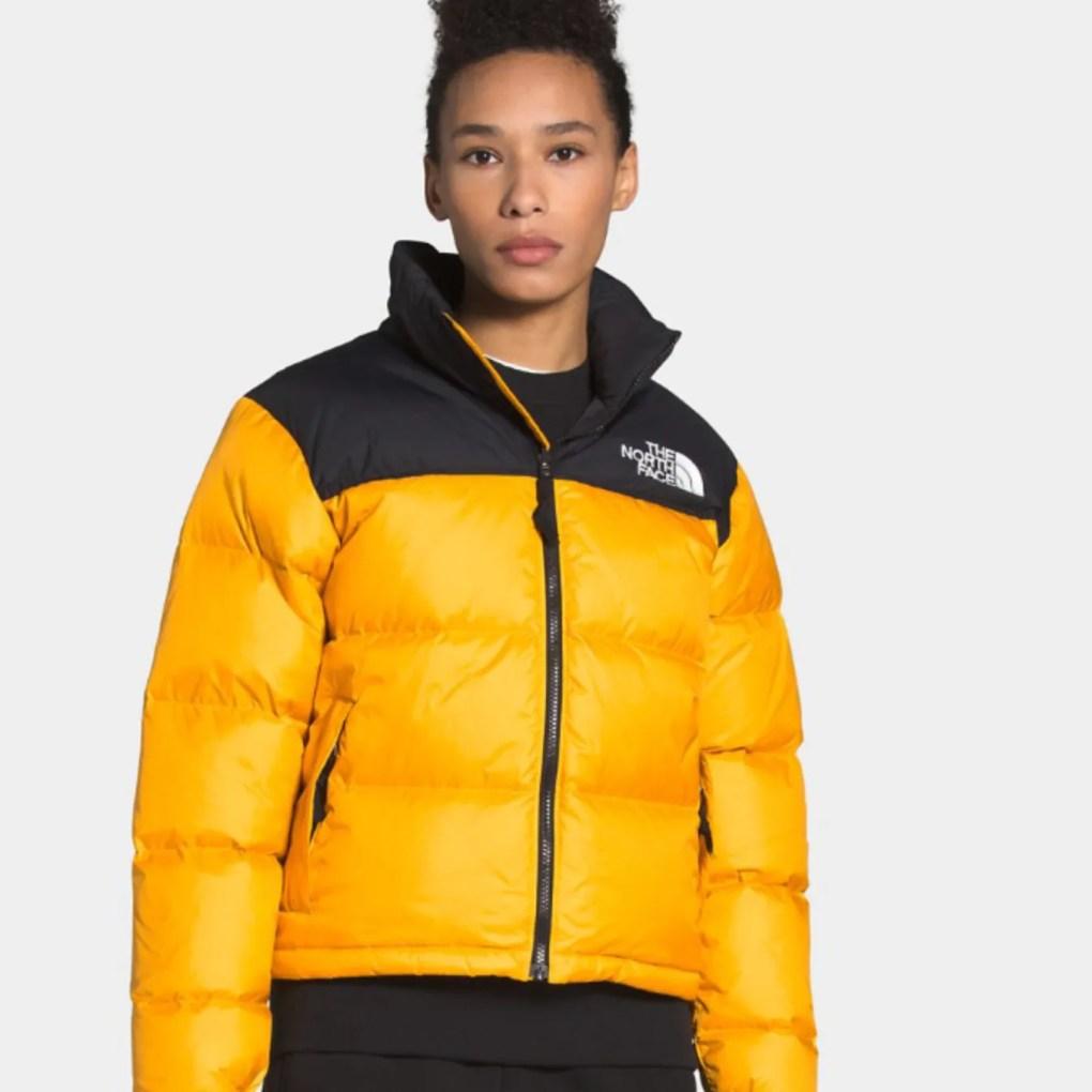 Image may contain: Clothing, Apparel, Coat, Human, Person, Jacket, and Raincoat