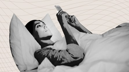 Woman with her phone in bed