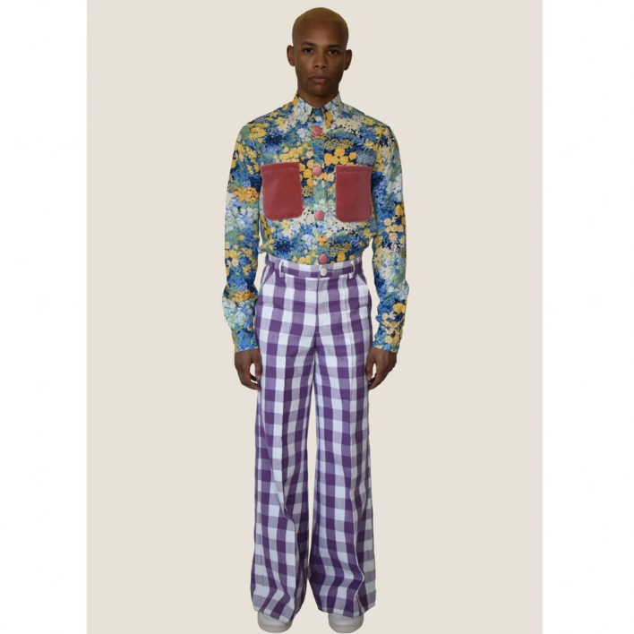 model wearing floral button up shirt and purple plaid pants