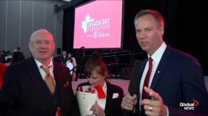 Chris Gailus speaks to two new Canadian citizens on Canada Day